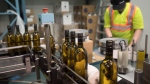 Bottles of wine are packaged at Grey Monk Winery in Kelowna, B.C., Wednesday, May 3, 2017. (THE CANADIAN PRESS/Jonathan Hayward)