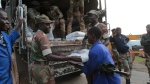 Soldiers handout food supplies to people in Chimanimani, southeast of Harare, Zimbabwe, Monday, March 18, 2019. (AP Photo/Tsvangirayi Mukwazhi)