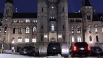 Prime Minister Justin Trudeau's motorcade sits parked below his West Block office on Parliament Hill as a marathon voting session continues into the night in the House of Commons in Ottawa on Wednesday, March 20, 2019. THE CANADIAN PRESS/Justin Tang