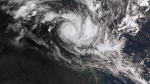 In a satellite image acquired from the Australian Bureau of Meteorology, Cyclone Trevor moves over the Northern Territory captured at 0810am AEDT, Tuesday, 19 March 2019. (Bureau of Meteorology/AAP Image via AP)