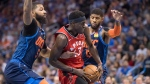 Toronto Raptors forward Pascal Siakam (43) drives to the basket between Oklahoma City Thunder forward Markieff Morris, left, and forward Paul George during the first half of an NBA basketball game Wednesday, March 20, 2019, in Oklahoma City. (AP Photo/Rob Ferguson)
