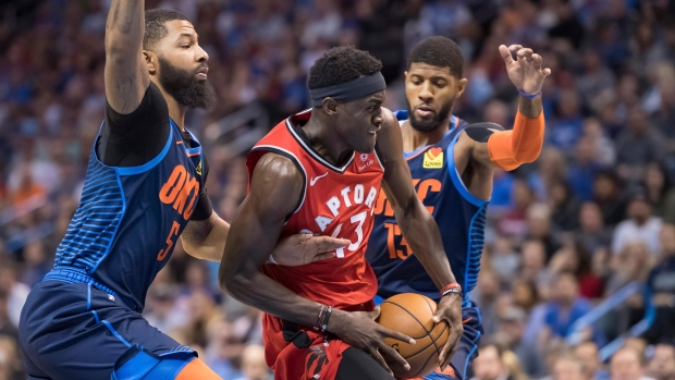 Toronto Raptors forward Pascal Siakam (43) drives to the basket between  Oklahoma City Thunder forward Markieff Morris 618681f25