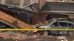 Houses, cars damaged after TTC bus crash