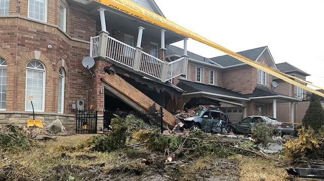 Polcie tape blocks off two homes on Oasis Boulevard in Scarborough where a TTC bus plowed into them on March 21, 2019.