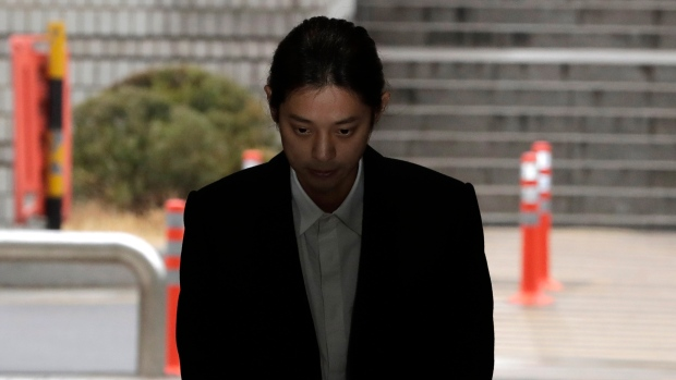 K-pop singer v arrives to attend a hearing at the Seoul Central District Court in Seoul, South Korea, Thursday, March 21, 2019. (AP Photo/Lee Jin-man)