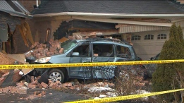 A TTC bus crashed into two homes in Scarborough on Thursday morning.