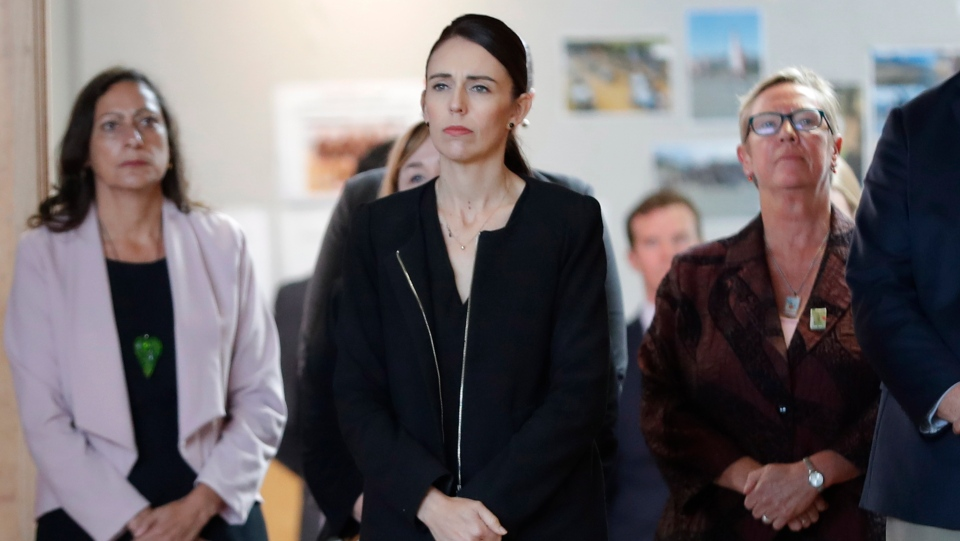 New Zealand's Prime Minister Jacinda Ardern, second from right, arrives during a high school visit in Christchurch, New Zealand, Wednesday, March 20, 2019. (AP Photo/Vincent Thian)
