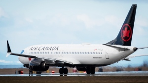 An Air Canada Boeing 737 Max 8 aircraft departing for Calgary taxis to a runway at Vancouver International Airport in Richmond, B.C., on March 12, 2019. THE CANADIAN PRESS/Darryl Dyck