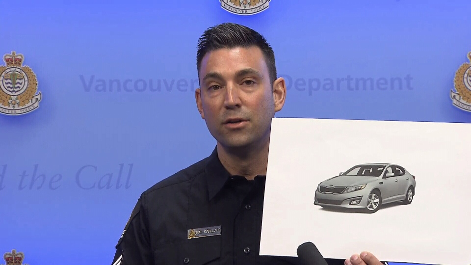 Vancouver Police Sgt. Jason Robillard holds a photo of a vehicle similar to the one police believe was involved in a hit-and-run.