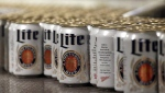 In this March 11, 2015 photo, newly-filled and sealed cans of Miller Lite beer move along on a conveyor belt, at the MillerCoors Brewery, in Golden, Colo. THE CANADIAN PRESS/AP Photo/Brennan Linsley