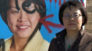 Joanne Gui, the Alberta Party candidate for Calgary-Edgemont, stands next to her campaign sign that was defaced with racial slurs and profanity