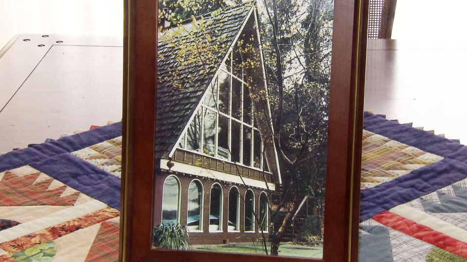 A cabin built by Nancy Strain's father is shown in a family photo.