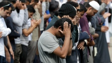 Muslims pray during Friday prayers