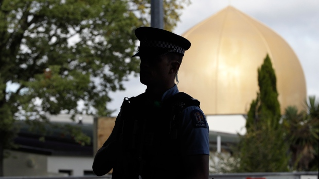 Armed police guard the Al Door mosque ahead of Friday prayers at Hagley Park in Christchurch, New Zealand, Friday, March 22, 2019. (AP / Mark Baker)
