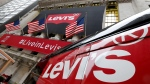 A Levi's banner adorns the facade of the New York Stock Exchange, Thursday, March 21, 2019. Levi Strauss & Co., which gave America its first pair of blue jeans, is going public for the second time. (AP Photo/Richard Drew)