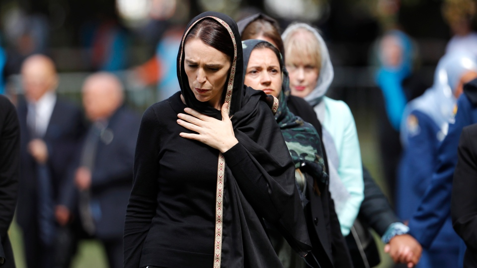 New Zealand Prime Minister Jacinda Ardern, front, leaves Friday prayers at Hagley Park in Christchurch, New Zealand, Friday, March 22, 2019. People across New Zealand are observing the Muslim call to prayer as the nation reflects on the moment one week ago when 50 people were slaughtered at two mosques. (AP Photo/Vincent Thian)