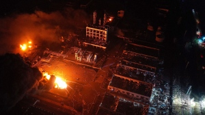 In this Thursday, March 21, 2019, aerial photo released by China's Xinhua News Agency, fires burn at the site of a factory explosion in a chemical industrial park in Xiangshui County of Yancheng in eastern China's Jiangsu province. (Ji Chunpeng/Xinhua via AP)