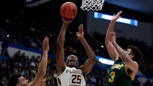 Florida State's Mfiondu Kabengele (25) goes to the hoop between Vermont's Isaiah Moll (14) and Anthony Lamb (3) during the first half of a first round men's college basketball game in the NCAA Tournament, Thursday, March 21, 2019, in Hartford, Conn. (AP Photo/Elise Amendola)