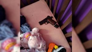 Toronto police find loaded handgun in child's crib
