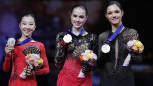 From left, Japan's Rika Kihira, Russia's Alina Zagitova and Russia's Evgenia Medvedeva display their silver, gold and bronze medals at Saitama Super Arena in Saitama, north of Tokyo, on March 22, 2019. (Andy Wong / AP)