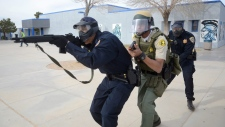 San Bernardino County Sheriff Department, Barstow Police Department and California Highway Patrol conducted an active shooter drill at Silver Valley High School in Yermo, Calif., Wednesday, Jan. 27, 2016. (David Pardo/The Victor Valley Daily Press via AP) MANDATORY