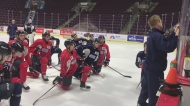 The Windsor Spitfires take a knee at practice while listening to head coach Trevor Letowski. (CTV Windsor)