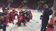 The Windsor Spitfires take a knee at practice while listening to head coach Trevor Letowski. (CTV Windsor)
