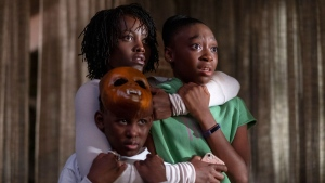 "This image released by Universal Pictures shows, from left, Evan Alex, Lupita Nyong'o and Shahadi Wright Joseph in a scene from ""Us,"" written, produced and directed by Jordan Peele. (Claudette Barius/Universal Pictures via AP)"