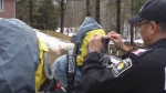 Police prepare to enter a massive meth lab as part of a search warrant in York Region. (YouTube/York Regional Police)