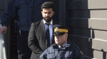 Jaskirat Singh Sidhu is taken out of the Kerry Vickar Centre by the RCMP following his sentencing for the Humboldt Broncos bus crash in Melfort, Sask., on Friday, March, 22, 2019. THE CANADIAN PRESS/Kayle Neis