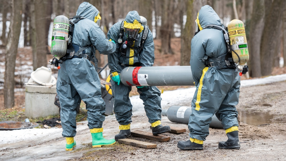 York Regional Police Organized Crime Bureau - Guns, Gangs and Drug Enforcement Unit remove canisters from a meth lab found in East Gwillimbury, Ont. (York Regional Police handout)