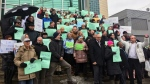 Religious leaders hold signs denouncing violence in Montreal on March 22, 2019 (CTV Montreal Angela Mackenzie)