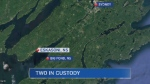 Two men were taken into custody in connection with a suspicious death in Eskasoni, Cape Breton on Thursday night.