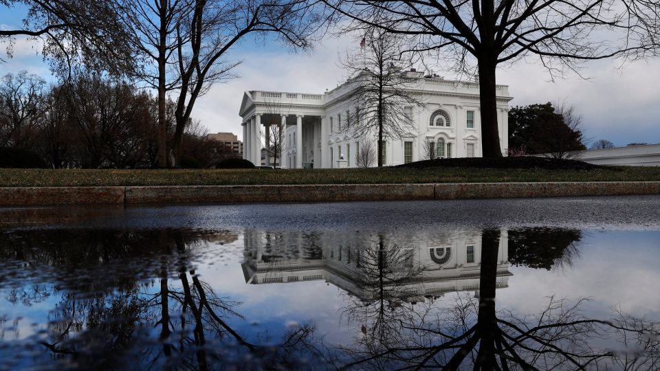 The White House in Washington is reflected in a puddle, on March 22, 2019. (Jacquelyn Martin / AP)