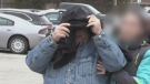 James Hewitt, 73, covers his face as he walks into a Barrie courthouse for sentencing after being found guilty of sexual assault.