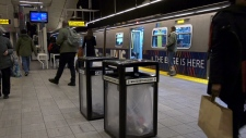 Waste bins are seen on the Canada Line in this image from March 2019.