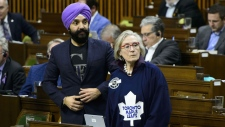 Innovation, Science and Economic Development Minister Navdeep Bains and Indigenous and Northern Affairs Minister Carolyn Bennett rise to vote during a marathon voting session in the House of Commons on Parliament Hill in Ottawa on Thursday, March 21, 2019. THE CANADIAN PRESS/Sean Kilpatrick