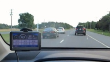 Drivers are seen in the left lane of a highway in B.C.