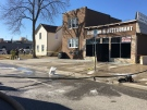 Investigators remain on scene at a commercial/residential fire on Glengarry Avenue on Saturday, March 23, 2019. (Ricardo Veneza / CTV Windsor)