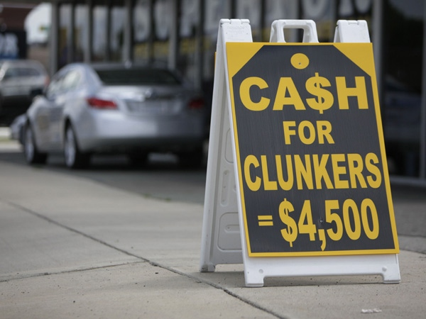 Cash for Clunkers signs are shown outside Superior Pontiac Buick GMC Friday, July 31, 2009 in Dearborn, Mich. The House has approved an additional $2 billion for government's 'cash for clunkers' program. (AP / Paul Sancya)