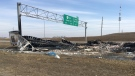 Wreckage of a semi tractor-trailer is seen in the centre median of Stoney Trail on Saturday, March 23, 2019.