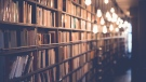 An image of a library by Janko Ferlic (Pexels)