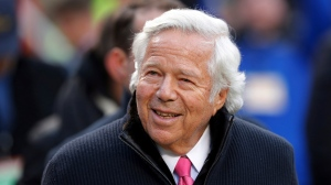 In this Jan. 20, 2019, file photo, New England Patriots owner Robert Kraft walks on the field before the AFC Championship NFL football game in Kansas City, Mo. (AP Photo/Charlie Neibergall, File)