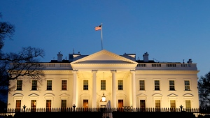 The White House is seen at dusk, Friday March 22, 2019, in Washington. (AP Photo/Jacquelyn Martin)