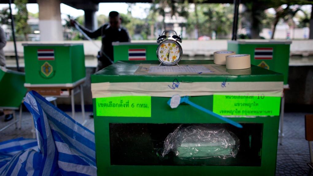 Thais vote in long-delayed poll pitting junta versus critics