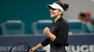 Bianca Andreescu, of Canada, reacts after winning her match against Angelique Kerber, of Germany, during the Miami Open tennis tournament Sunday, March 24, 2019, in Miami Gardens, Fla. (AP Photo/Gaston De Cardenas)