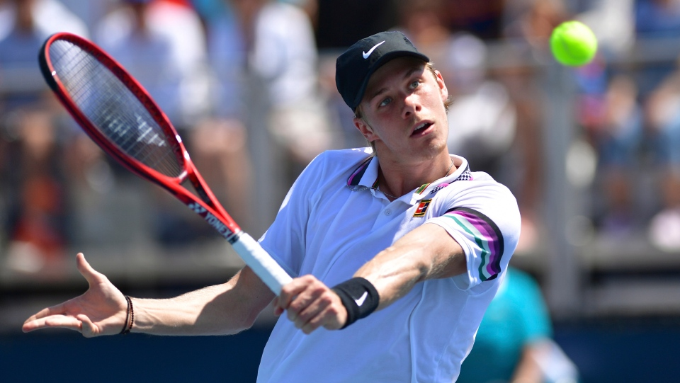 Denis Shapovalov, of Canada, returns a volley to Daniel Evans, of Great Britain, during the Miami Open tennis tournament, Saturday, March 23, 2019, in Miami Gardens, Fla. (AP Photo/Jim Rassol)