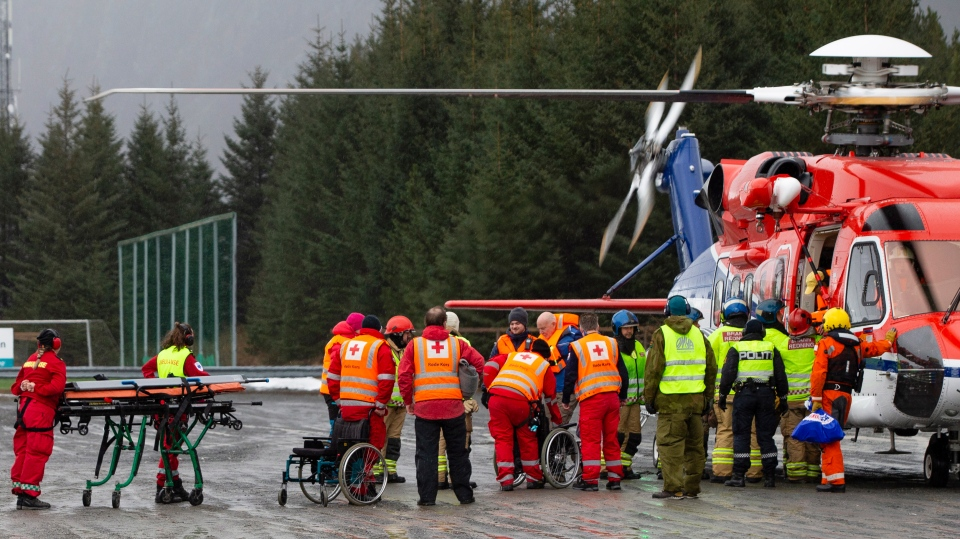 Passengers are helped from a rescue helicopter in Fraena, Norway, Sunday March 24, 2019, after being rescued from the Viking Sky cruise ship. (Svein Ove Ekornesvag/NTB Scanpix via AP)