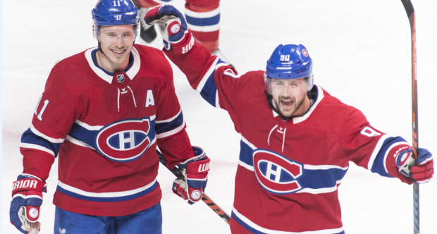 Montreal Canadiens' Brendan Gallagher (11) celebrates with teammate Tomas Tatar after scoring during third period NHL hockey action against the Buffalo Sabres, in Montreal, Saturday, March 23, 2019. THE CANADIAN PRESS/Graham Hughes