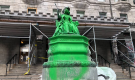 An effigy of 19th Century monarch Queen Victoria - located on Sherbrooke St., outside McGill University - was doused in green paint by unknown perpetrators sometime Sunday morning. (Photo courtesy CJAD 800)